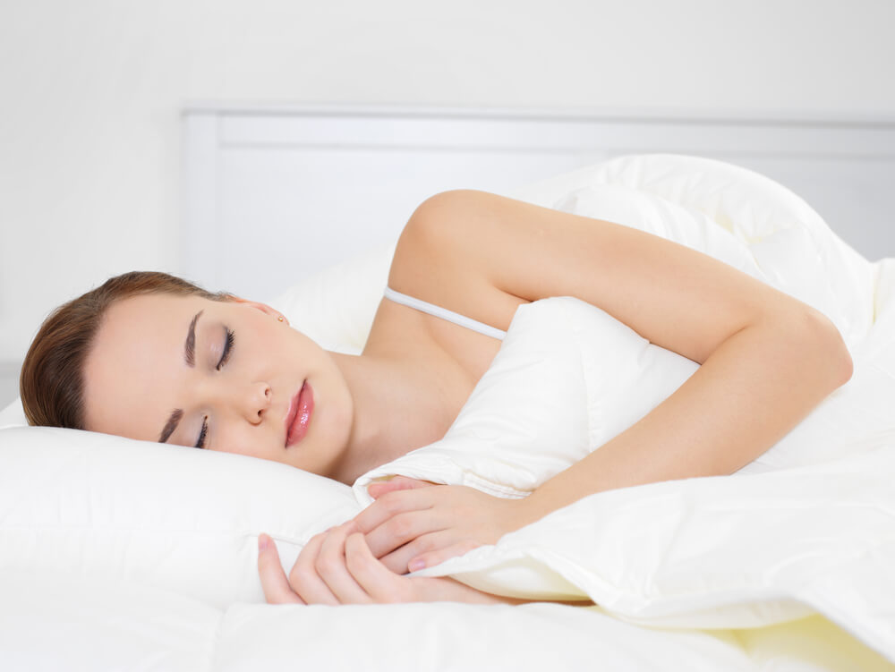Woman sleeping soundly on her side