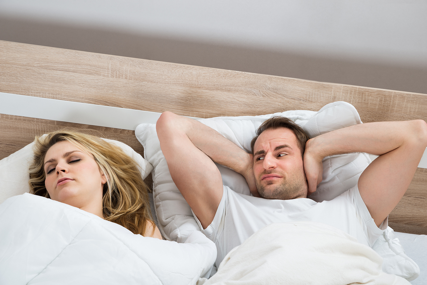 Woman keeping husband up with her snoring