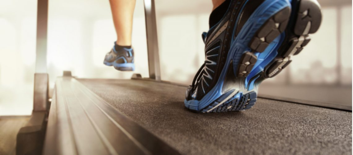 Closeup of a person running on a treadmill